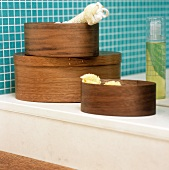 Wooden boxes on a shelf in a bathroom