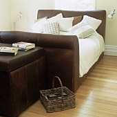 A double bed with an upholstered bedstead in a bedroom