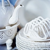 White porcelain crockery (a colander, a teapot and plates)