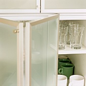 A kitchen cupboard with folding doors