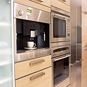 A kitchen with fitted electrical appliances