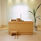 A wooden pool with sauna utensils