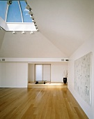 An empty Oriental-style living room or meditation room with a skylight