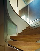A modern flight of stairs with a glass balustrade