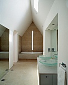 Sanctified ambience in modern bathroom in converted attic