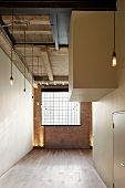 English loft with industrial window in brick wall and interlocking, white cubist structures
