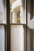 A transom window with semi-opaque glazing