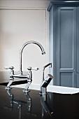A retro-style chrome kitchen tap