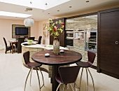 High bistro table in dark wood with bar stools in designer kitchen