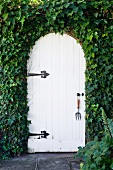 White door surrounded by ivy