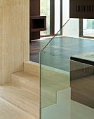 Stone steps with glass panel balustrade