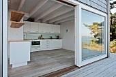 Open sliding terrace door with view of kitchen