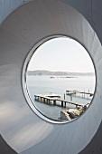 View of jetties on a lake through circular window