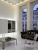 Minimalistic modern living room with ceiling-height arched windows