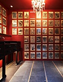 Red room with photo gallery and grey tiled floor