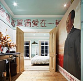 Ensuite bathroom with mural and Chinese characters on wall above open bedroom wall