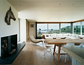 Open-plan living and dining room with panoramic window