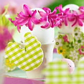Eggs in egg cups decorated with hyacinth flowers