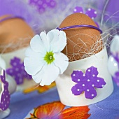 Easter eggs in decorated egg cups