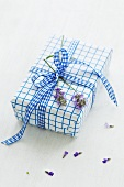A present decorated with lavender flowers