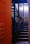 Industrial stairway and house entrance with letterboxes