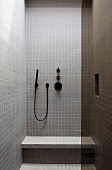 Tiled modern bathroom with purist look