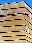 Horizontal wood cladding on corner of house
