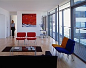 Espresso break in modern living room with coloured armchairs