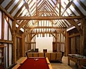 Games tables in open-plan living room of converted barn