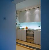 View of functional kitchen through open doorway