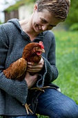 Woman holding live hen
