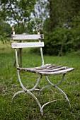 A garden chair in a field