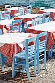 Tables belonging to a Greek taverna on a beach
