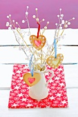 Heart-shaped Christmas biscuits hanging on a twig