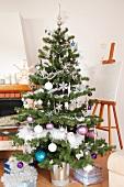A Christmas tree and an easel