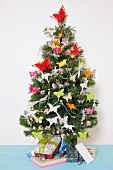 A Christmas tree decorated with butterflies and presents