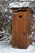 Wooden hut with dry toilet in garden