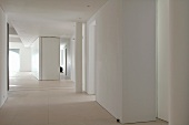 Suite of rooms in white loft interior with free-standing installations