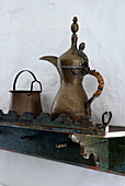 Antique jugs on bracket shelf
