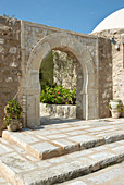Stone with rounded archway in courtyard (Tunisia)