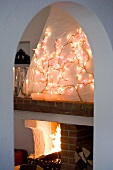 A fireplace room decorated for Christmas