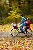 Young couple cycling to a picnic