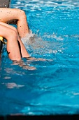 Feet in a swimming pool