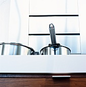 Stainless steel pots in kitchen