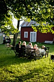 A family eating in the garden (Sweden)