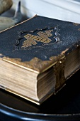 Valuable, antiquarian edition of English bible with embossed leather front and brass clasp