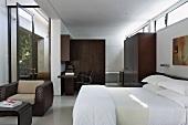 Modern bedroom with dark wood wardrobes
