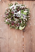 A green and white Christmas wreath