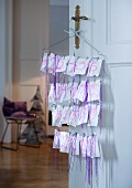Hand-crafted Advent calendar made of wire coathangers and paper bags