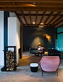 Pink, plastic chair in modern interior with wood-beamed ceiling